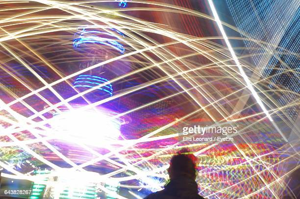 Blurred Motion Of Spinning Carousel In Amusement Park At Night