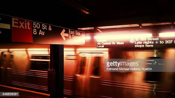 blurred motion of train arriving at station - new york city subway stock pictures, royalty-free photos & images