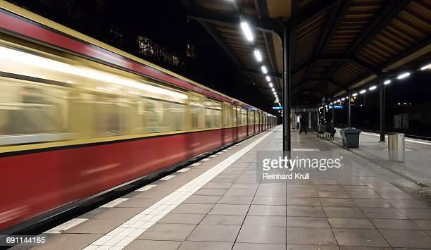 Blurred Motion Of Train At Illuminated Railroad Station