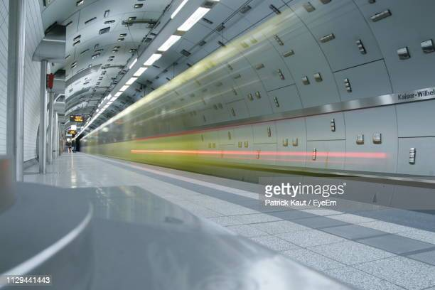 blurred motion of train at railroad station - essen germany stock pictures, royalty-free photos & images