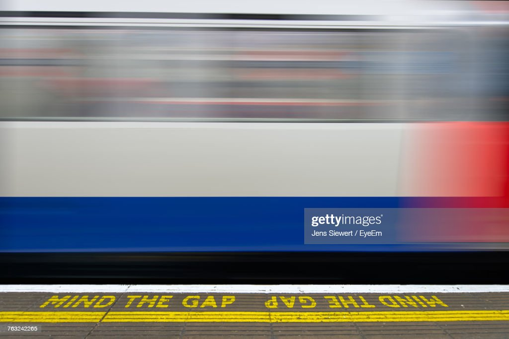 Blurred Motion Of Train At Railroad Station : Stock-Foto