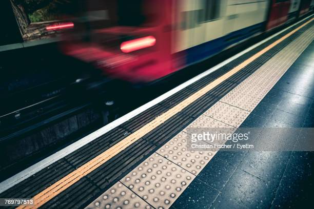 blurred motion of train at railroad station - tramway stock pictures, royalty-free photos & images