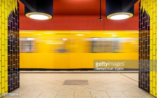 blurred motion of train at subway station - berlin stock pictures, royalty-free photos & images