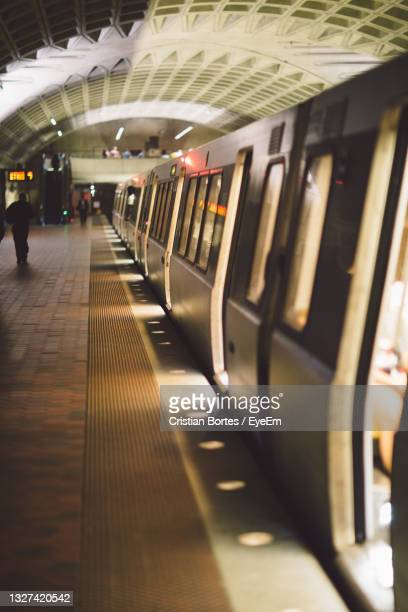 blurred motion of train at subway station - bortes stock pictures, royalty-free photos & images