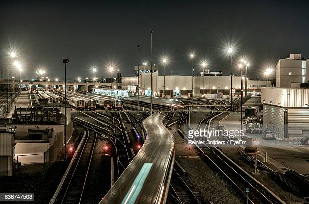 blurred motion of train at yard - shunting yard stock photos and pictures