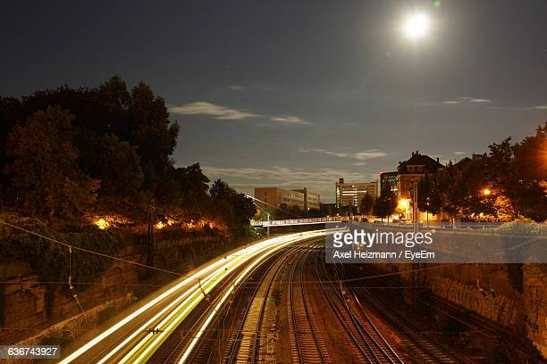 Blurred Motion Of Train Moving Against Sky At Night