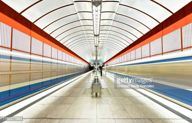 blurred motion of trains at subway station kreillerstrasse, munich, germany - christian beirle stock pictures, royalty-free photos & images