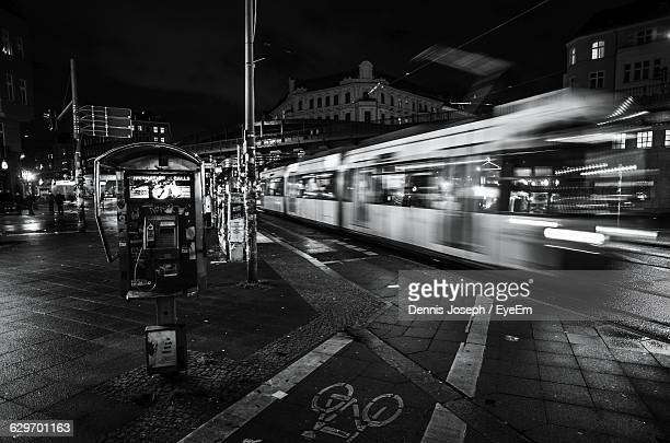 Blurred Motion Of Tram On Street In City At Night