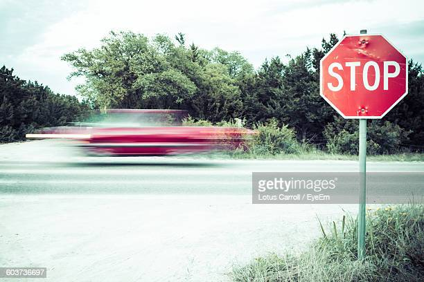 Blurred Motion Of Truck Moving On Road