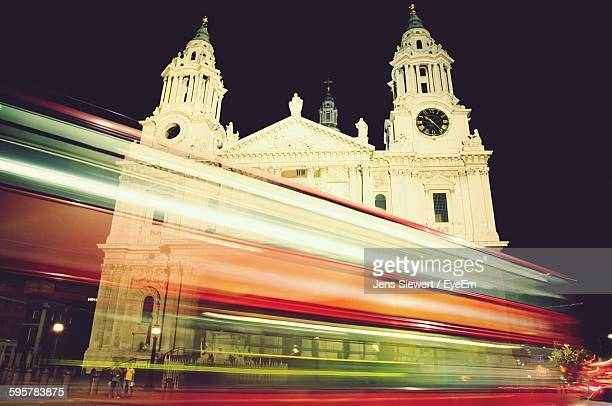 Blurred Motion Of Vehicles In City Against St Paul Cathedral Against Sky At Night