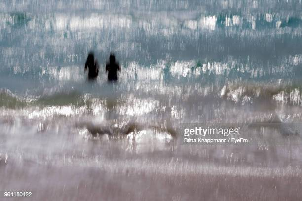 Blurred Motion Of Women In Sea