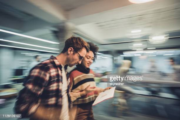 blurred motion of young entrepreneurs reading reports in the office. - busy stock pictures, royalty-free photos & images