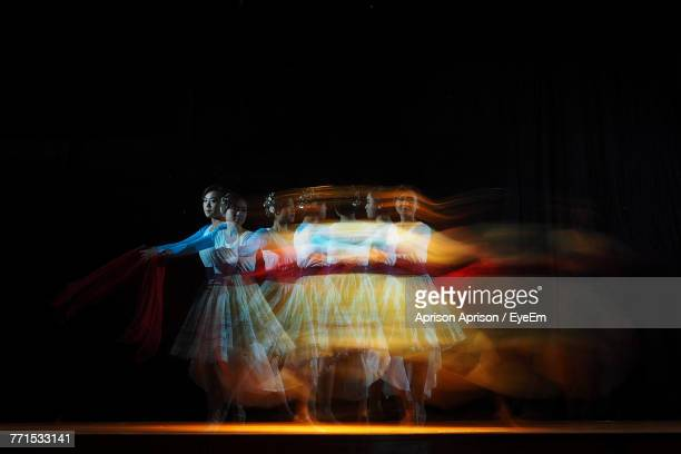 Blurred Motion Of Young Woman Dancing On Stage