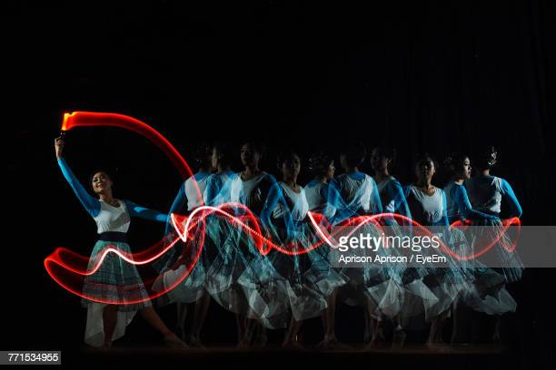 blurred motion of young woman dancing on stage - long exposure stock pictures, royalty-free photos & images