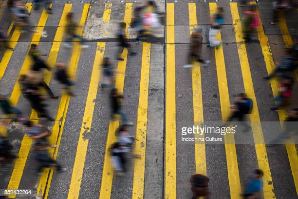 blurred motion on city street, hong kong - pedestrian crossing stock photos and pictures