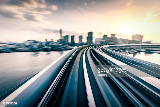 blurred motion on the subway in tokyo - futuristic stock pictures, royalty-free photos & images