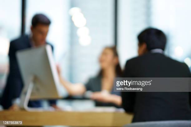 blurred motion photography of business people meeting at conference table - defocussed stock pictures, royalty-free photos & images