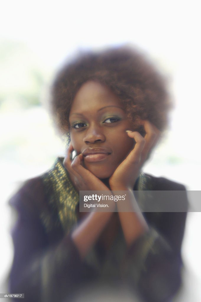 Blurred Motion Portrait of a Woman with an Afro : Stock Photo