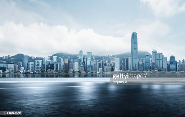 blurred motion road by victoria harbor,hong kong - victoria harbour hong kong stockfoto's en -beelden