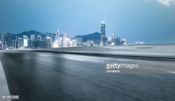 blurred motion road toward victoria harbor,Hong Kong