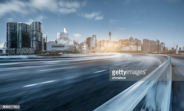 blurred motion road travel through modern skyscrapers of Sydney
