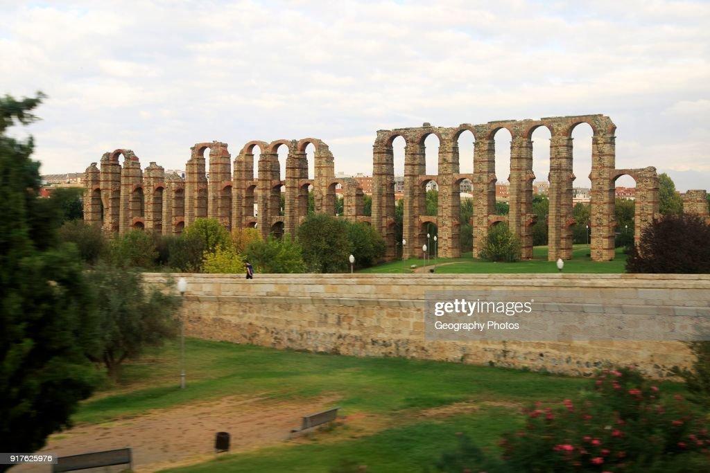 Blurred motion shot from speeding train of Roman aqueduct, Acueducto de Los Milagros, Merida, Extremadura, Spain : News Photo