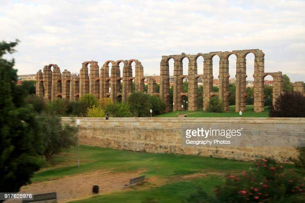 Blurred motion shot from speeding train of Roman aqueduct Acueducto de Los Milagros Merida Extremadura Spain