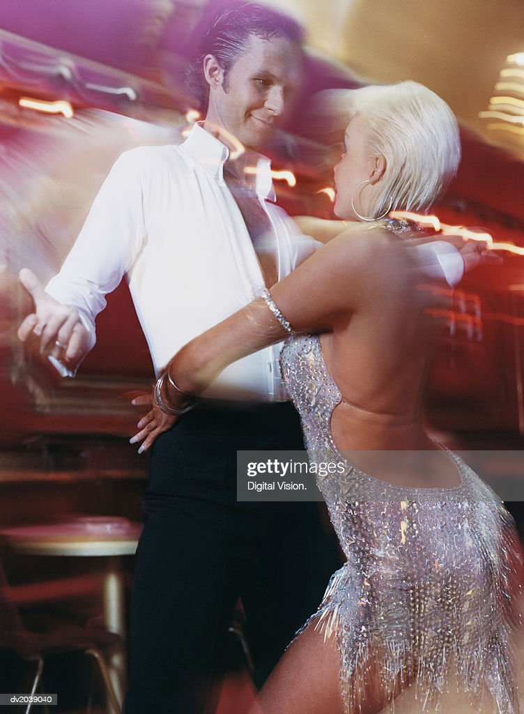 Blurred Motion Shot of a Couple Ballroom Dancing : Stock Photo