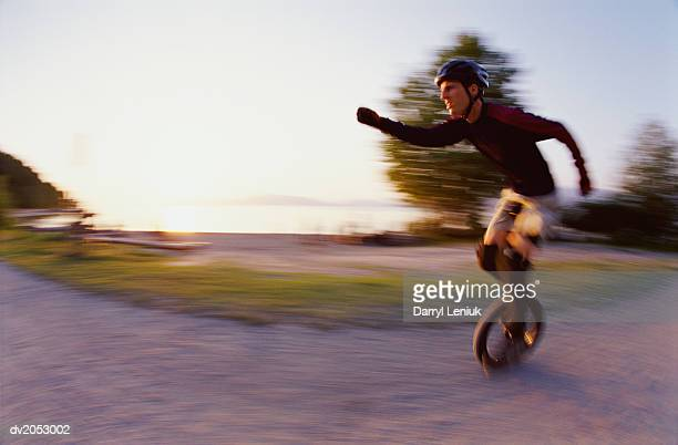 Blurred Motion Shot of a Man Riding a Monocycle