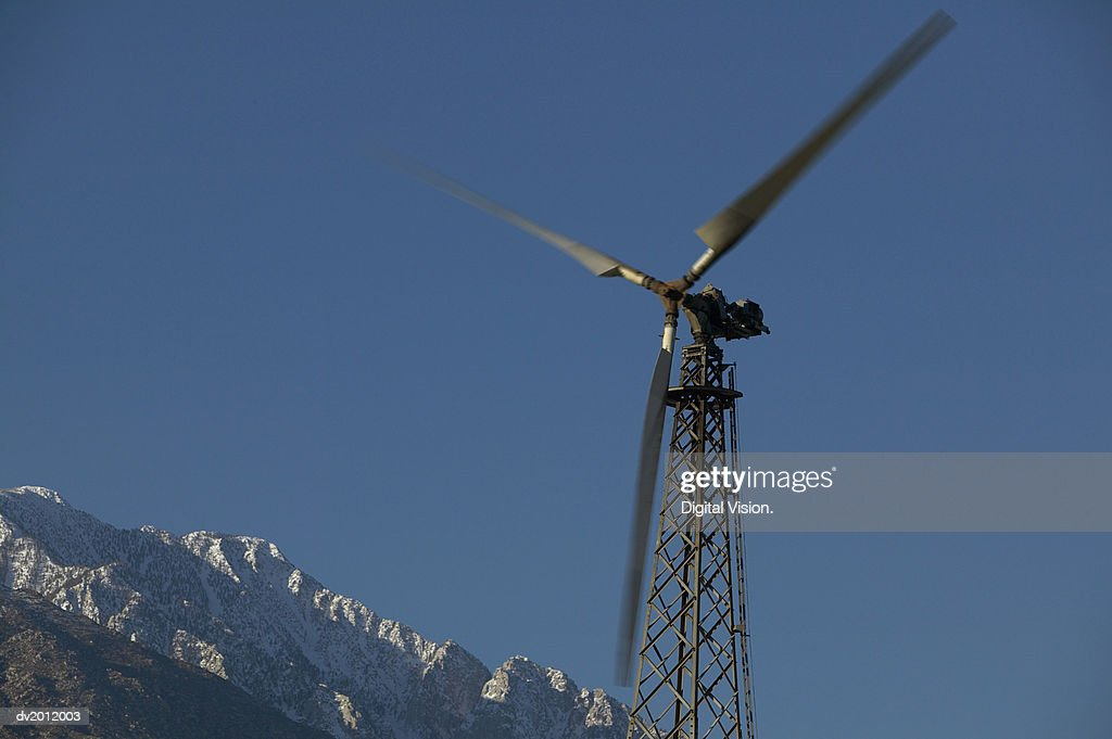 Blurred Motion Shot of a Revolving Wind Turbine : Stock Photo