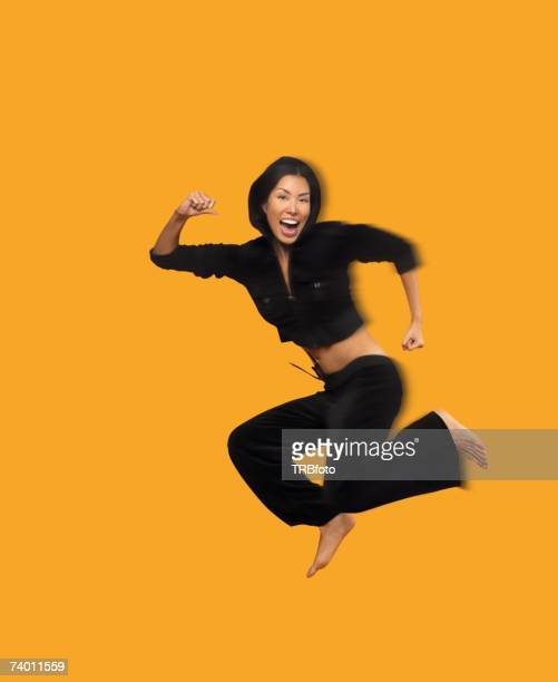 Blurred motion shot of Asian woman jumping
