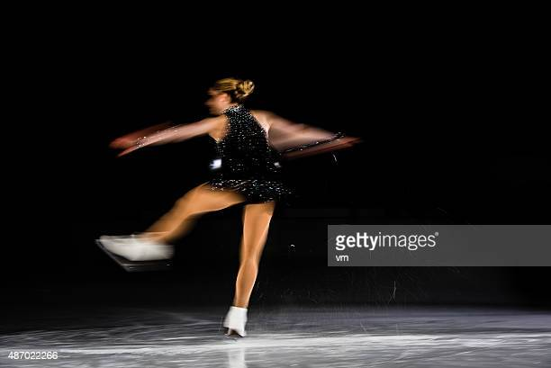 blurred motion shot of figure female skater performing - spinning stock pictures, royalty-free photos & images