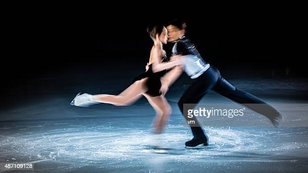 Blurred motion shot of figure skating pair performing
