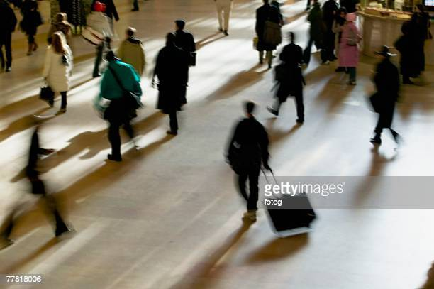 blurred motion shot of people, grand central station, new york city - grand central station stock photos and pictures