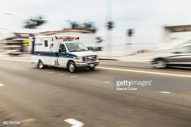 Blurred motion shot of speeding ambulance