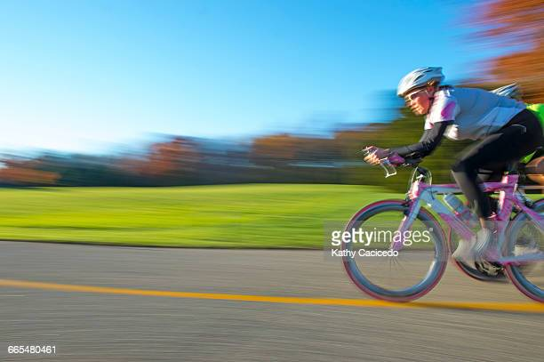 Blurred motion side view of cyclist cycling