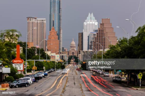 blurred motion view of cars driving in austin cityscape, texas, united states - austin texas stock pictures, royalty-free photos & images