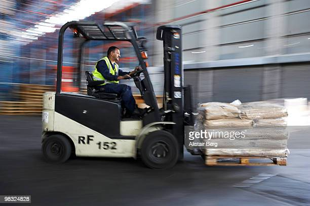 Blurred motion view of forklift truck
