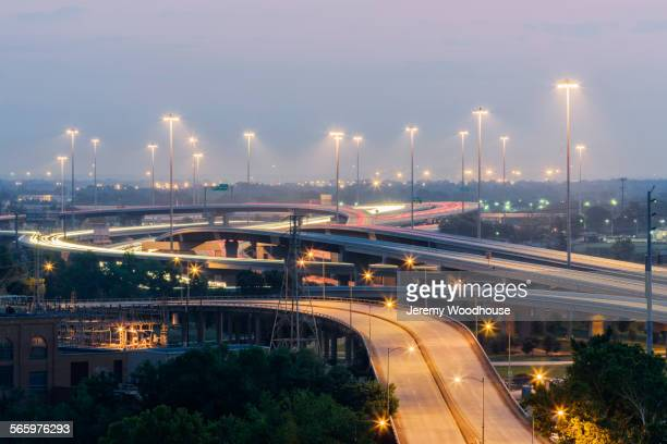 Blurred motion view of streetlights over traffic on highways at night, Houston, Texas, United States