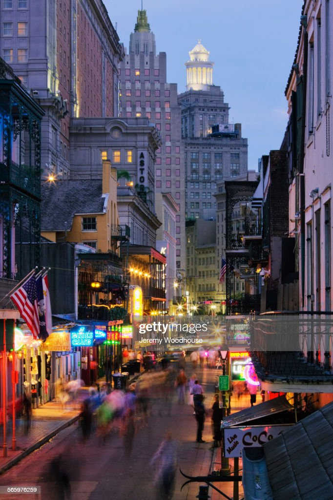 Blurred motion view of tourists on Bourbon Street at night, New Orleans, Louisiana, United States : Stock Photo