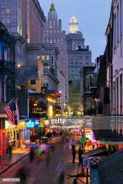blurred motion view of tourists on bourbon street at night, new orleans, louisiana, united states - new orleans french quarter stock photos and pictures