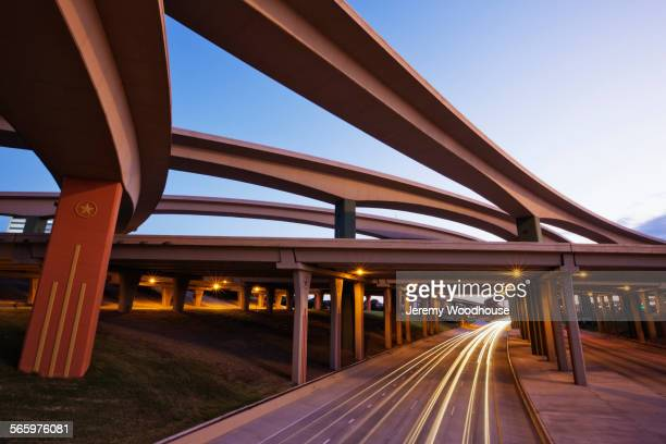 blurred motion view of traffic driving on highway underpass - dallas stock pictures, royalty-free photos & images