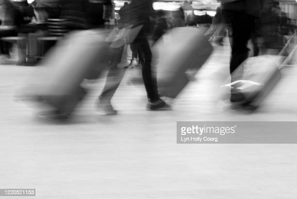 blurred movement of travellers with luggage - lyn holly coorg stock pictures, royalty-free photos & images