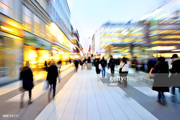 Blurred pedestrians in shopping district at Christmas time