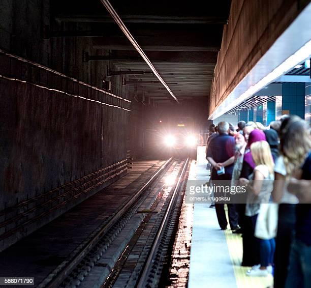 Blurred people on subway platform waiting the metro