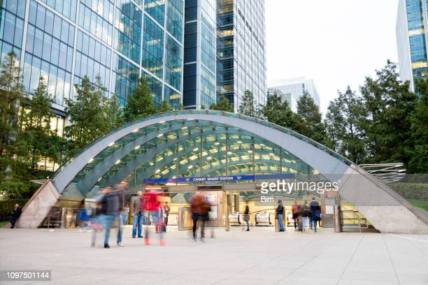 blurred people walking in front of modern office building, london - subway station stock pictures, royalty-free photos & images