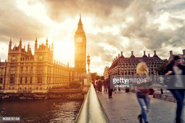 blurred people walking on westminster bridge at sunset - city of westminster london stock pictures, royalty-free photos & images