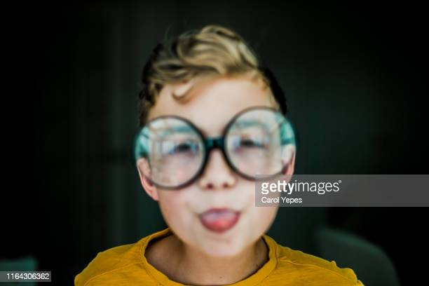 blurred portrait of a boy with glasses.myopia concept - myopia stock photos and pictures