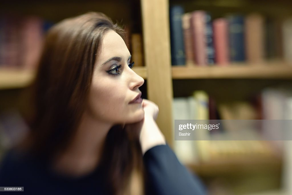 blurred profile of a woman gazing into the distance : Foto stock