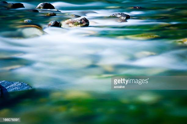 blurred river - pebble stock photos and pictures